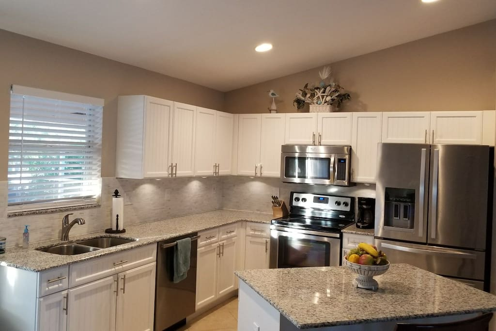 Newly renovated kitchen. Granite counters, marble backsplash and all new maple cupboards.