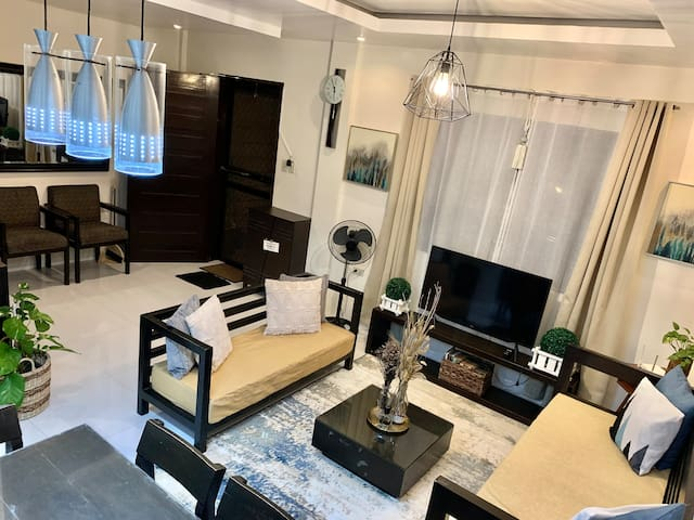 """Living area with 3 seater sofa, daybed & 42"""" smart tv"""