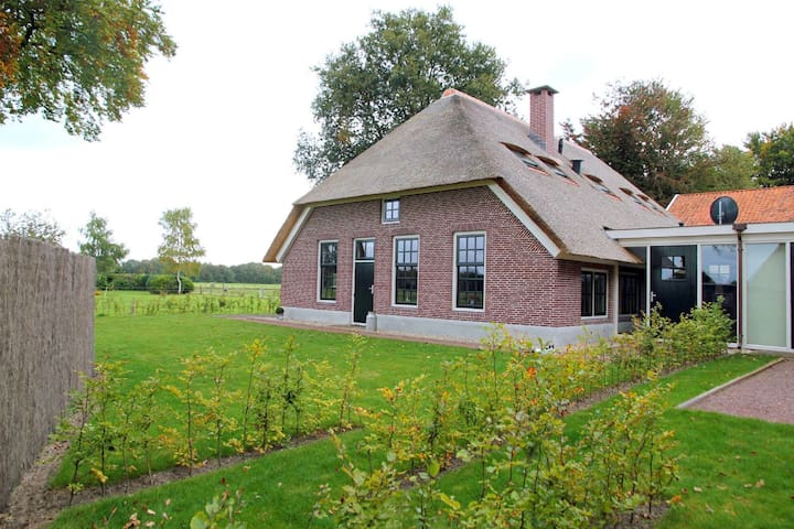 Large farmhouse consisting of two connected parts, suitable for large groups
