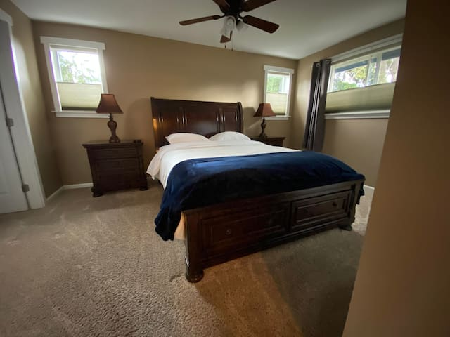 Master bedroom. Queen with walk-in closet, wall mounted TV and ensuite bathroom. Window-mounted AC unit available for those warm summer evenings.
