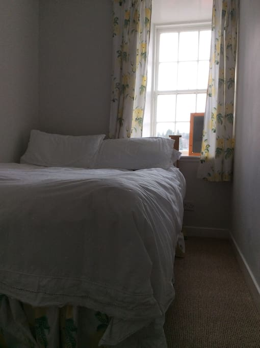 The cosy bedroom has a comfy double bed.