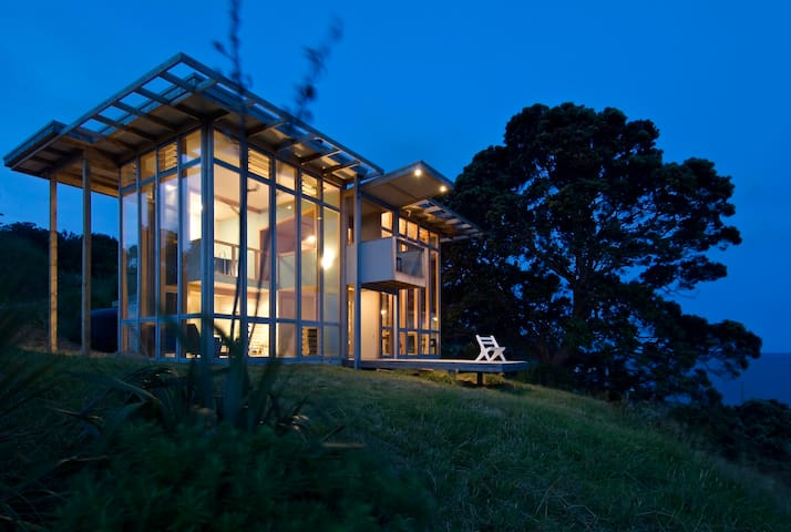 A glass house overlooking the ocean