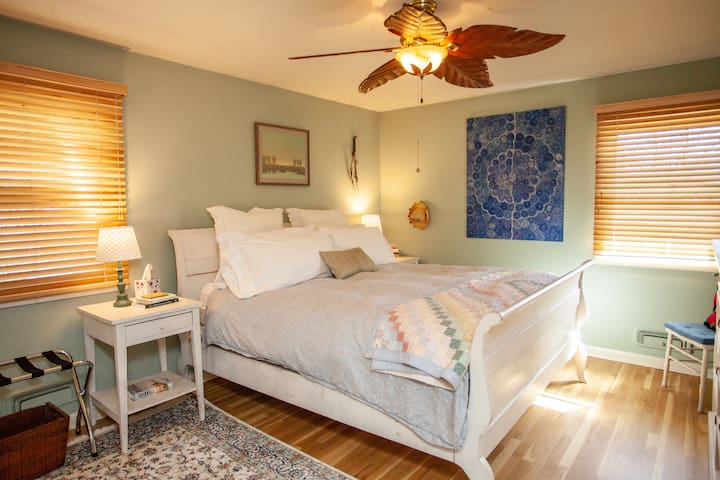 Welcome to the large, upstairs maser bedroom with a cozy king sized bed.