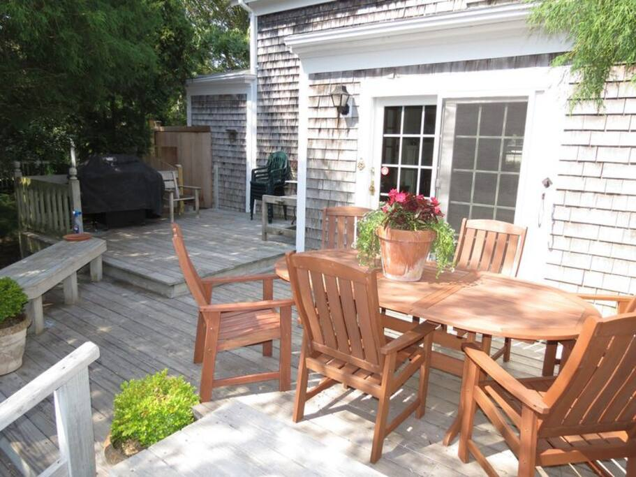 Comfortable outdoor living area with gas grill