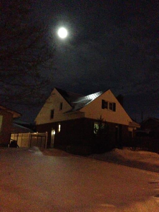 Winter night image - light is on in main floor bed/bath
