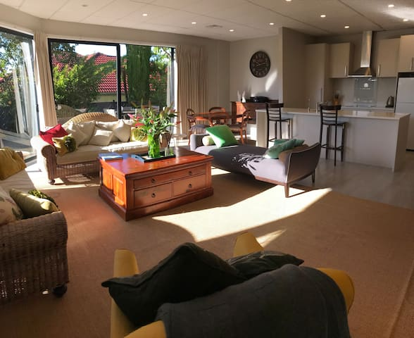 Large open plan living and dining/kitchen opening to the sunny garden.
