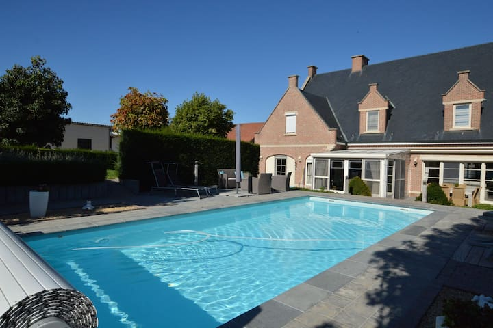 Comfortably furnished holiday home with swimming pool, jacuzzi and sauna on a farm
