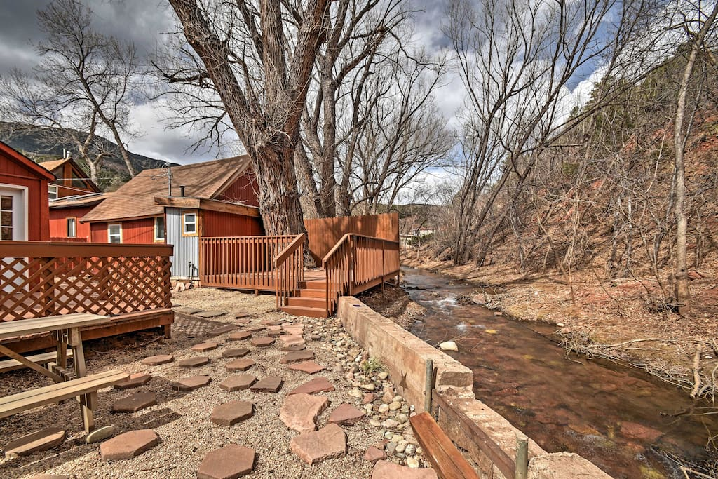 Spend your days lounging by the river when you stay at this charming cabin on the waters of Fountain Creek.
