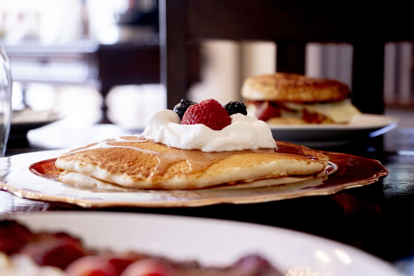 Hot pancakes with fruit or a wide variety of sauces and syrups.