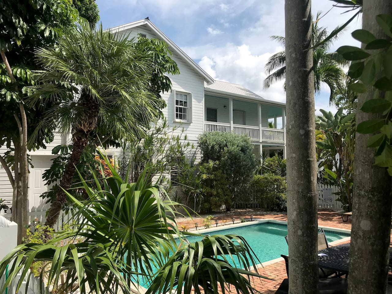 True Paradise is on the second floor.  The views from wrap around porch is overlooks the landscaped grounds and pool area.