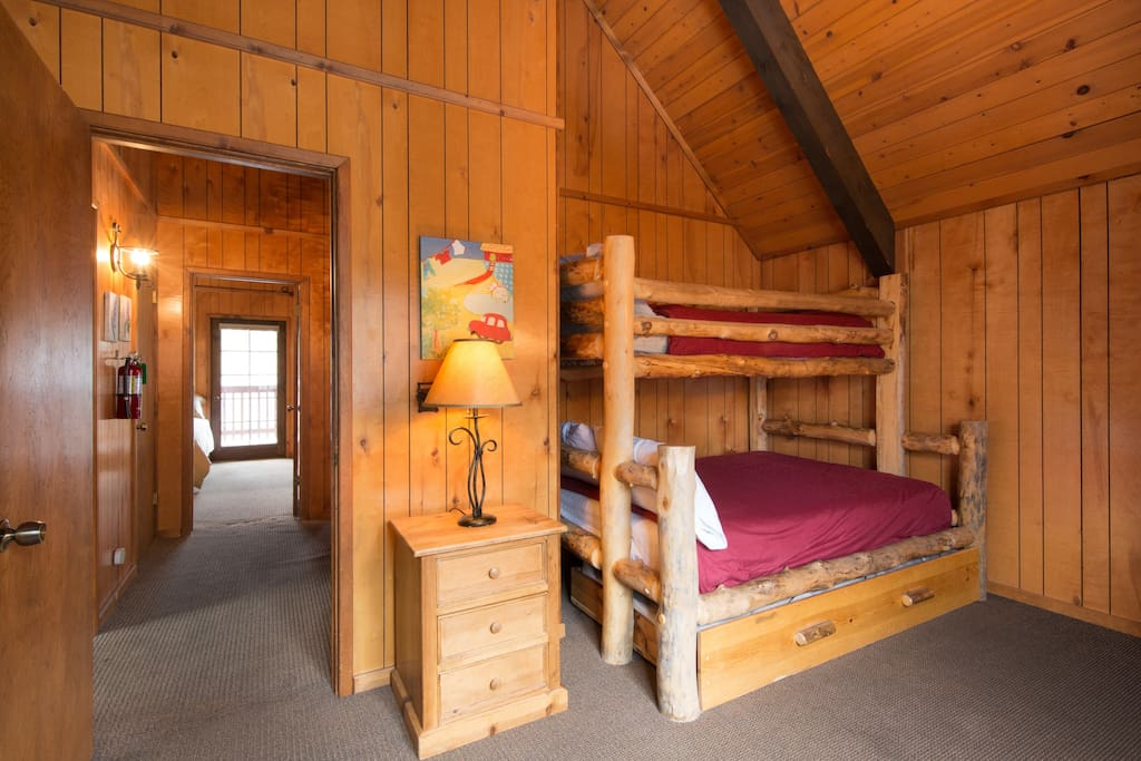 Upstairs bunk room features twin over full bed with a twin trundle. Sleeps four!