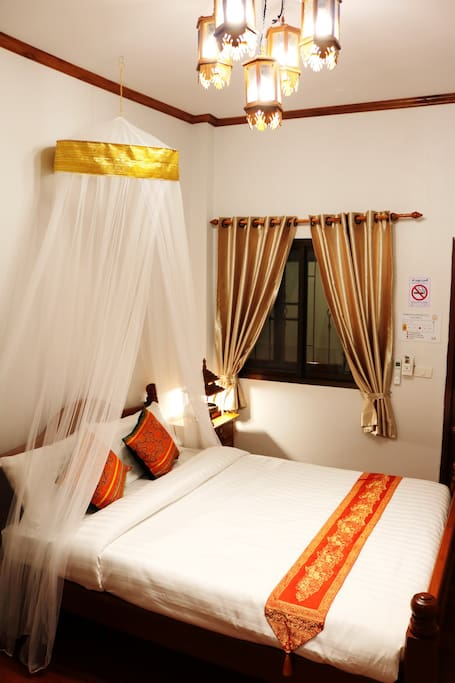 Junior Deluxe Room at Apilapa Hotel & Hostel. Located in Old town Chiang Mai, Thailand.