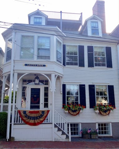 Lucy's Opus is a grand and charming home located in downtown Nantucket.  Decorated here for the annual 4th of July festival, this home offers every amenity a vacationer could be looking for. Less than 3 minutes to Main Street, Nantucket.