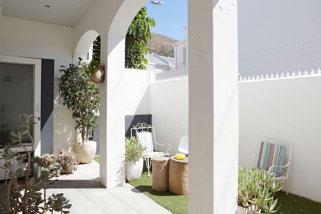 Lounge leads to sunny courtyard