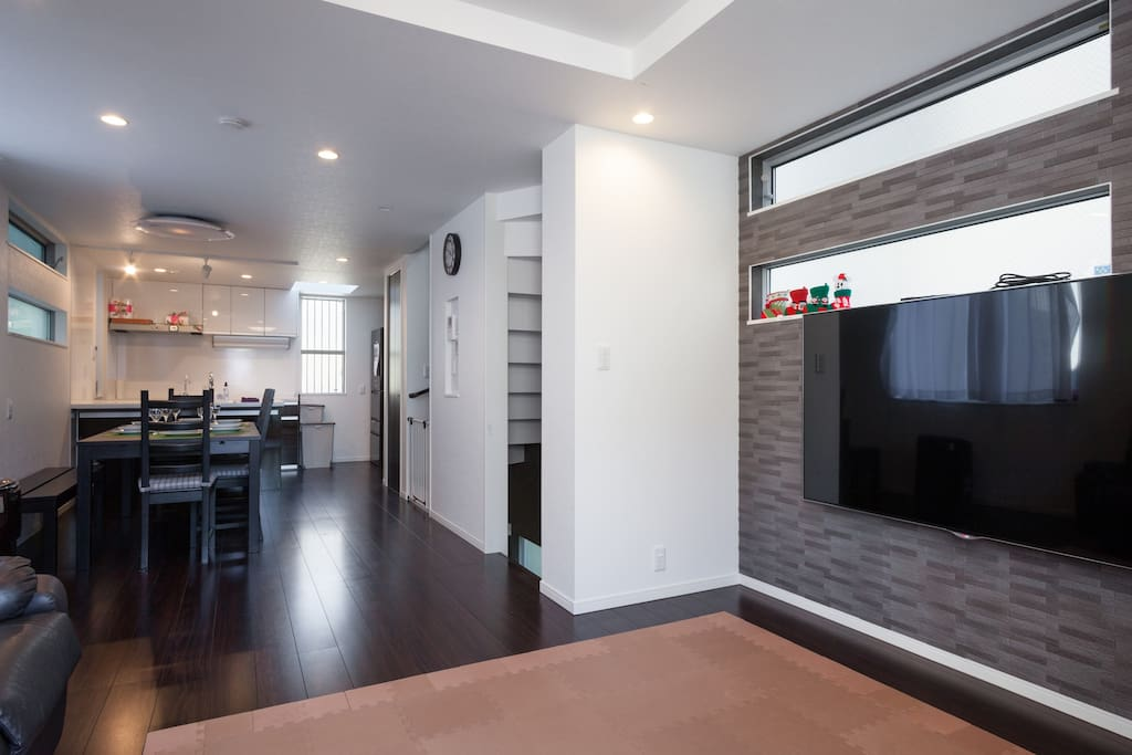 """Dining, living room and kitchen.  65"""" 4K Smart TV."""
