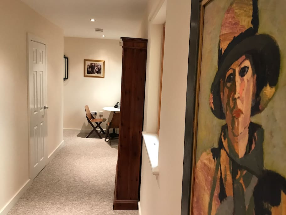 Hallway leading to main living space, bedroom and bathroom