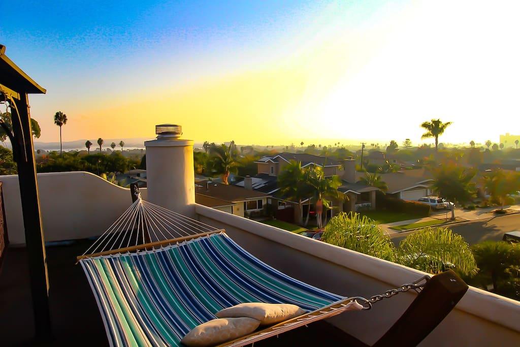 Soak in the fresh sea breeze in the hammock watching the sun set over the ocean