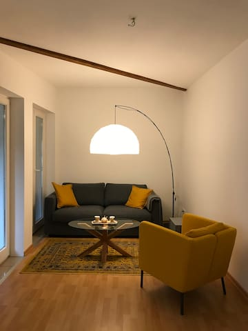 living area, sofa bed (1,40 x 2,00m), arm chair and stand lamp