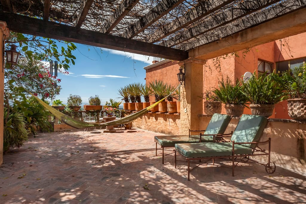 Gorgeous terrace with hammock, lounge chairs and plenty of space for your afternoon siesta or yoga practice!