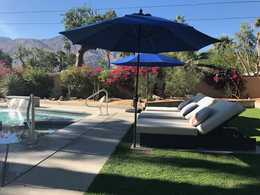 All new backyard redo as of 10/17! Work on your tan or relax in the shade as you drift away on one of the bed-sized loungers underneath the new lush grass, to the peaceful sounds of the waterfall.