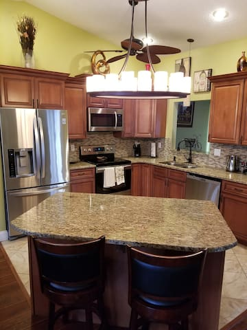 Renovated kitchen with new appliances and large island
