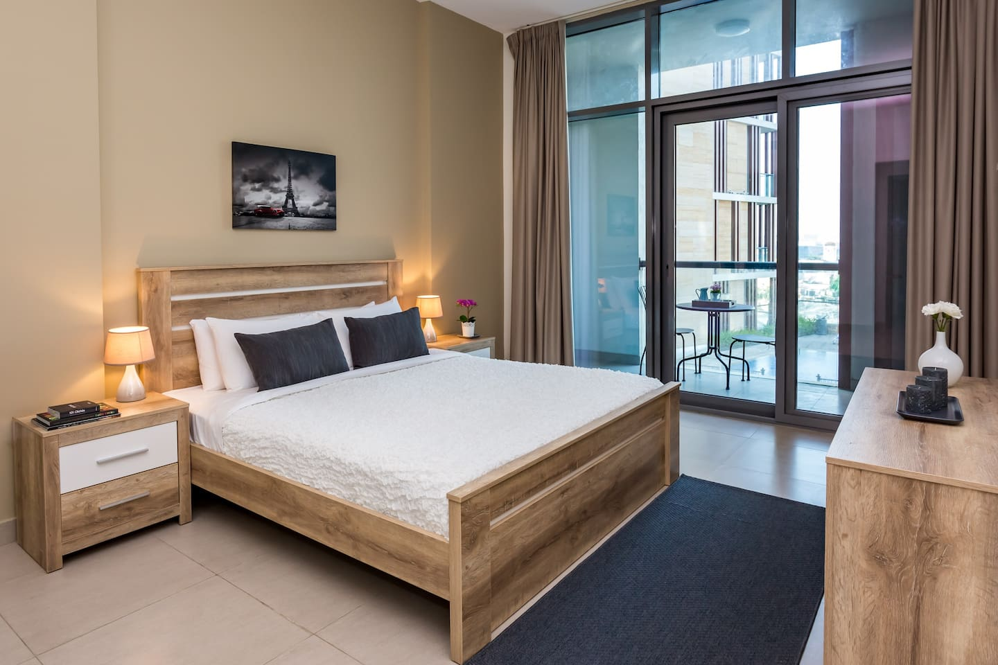 A spacious bedroom has access to the balcony which in return helps to fill the room with natural light