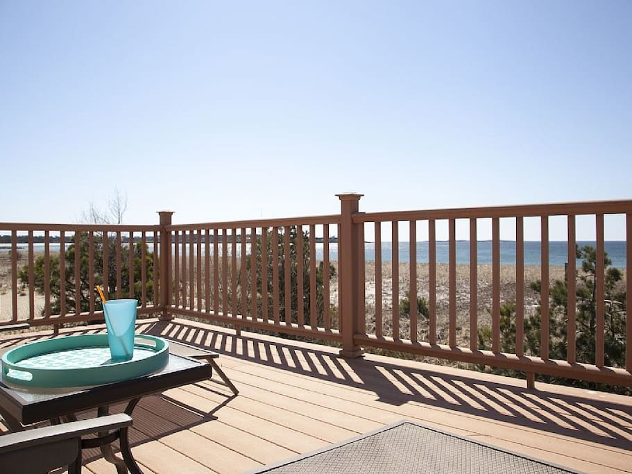 View from deck to the Ocean with lounge chairs