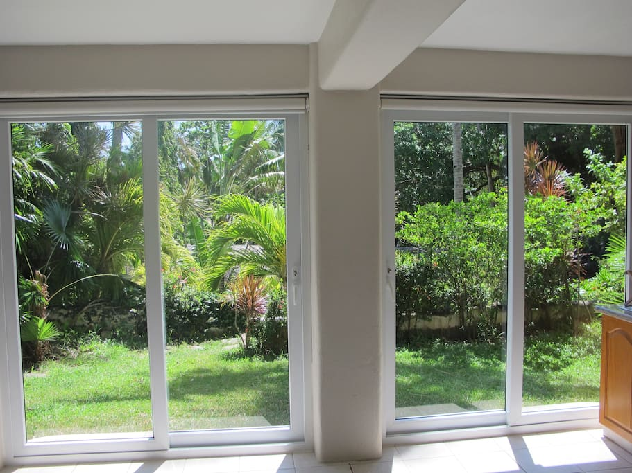 View of your private lawn and garden right outside the sliding doors.