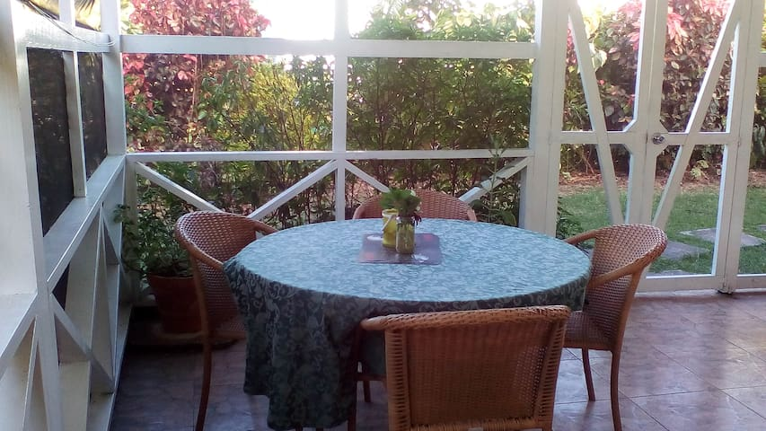 Private screened-in patio which overlooks your own garden and outdoor area.  The patio is cool, bright and comfortable; insect screens have been installed for your added comfort.