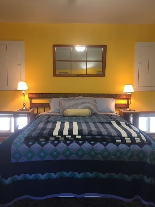 Guestroom 2,  Large 16' X 14', Queen Bed, table and refrigerator