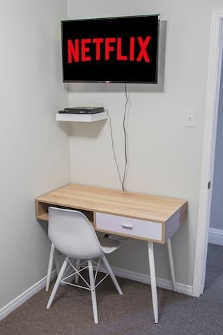 Work desk with Netflix in bedroom 1
