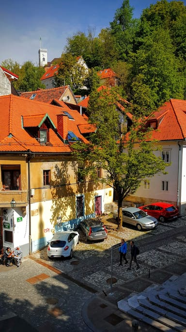 Ljubljana castle, view from the kitchen window. (This is a tourist street on a walk only area, with a way, where you can walk to the Ljubljana castle.)