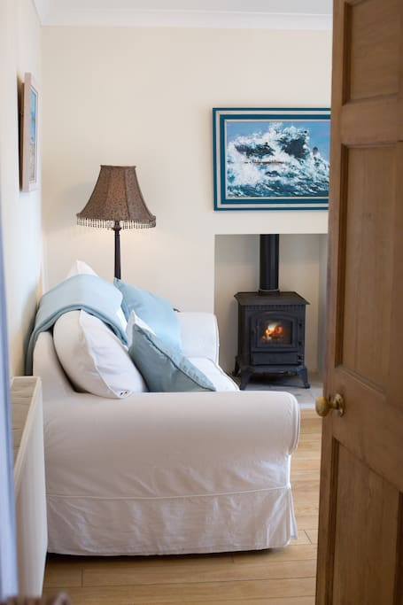 Comfortable sofa-bed and gas fire.