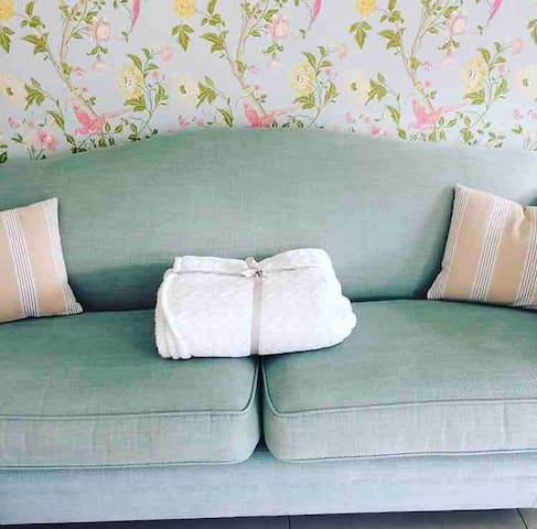 Cosy up on the Laura Ashley sofa!