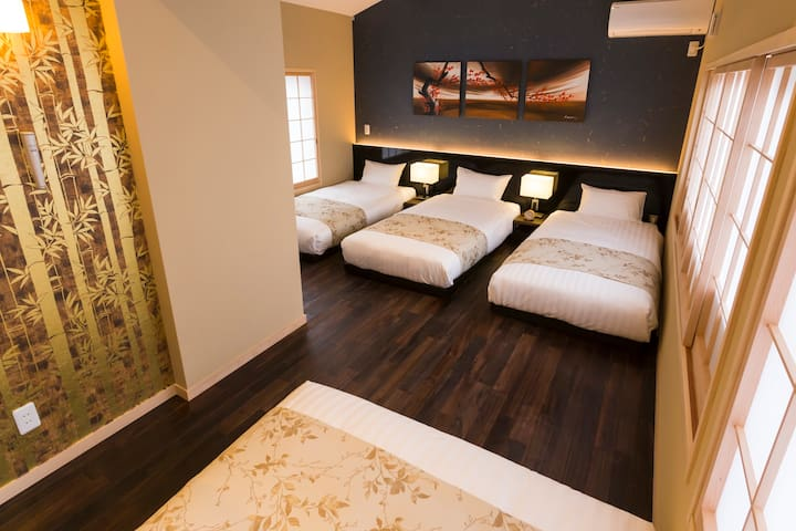 Bed room with 3 single beds and 1 double bed.
