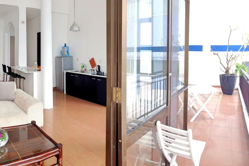 Fully equipped kitchen in open space with a big balcony