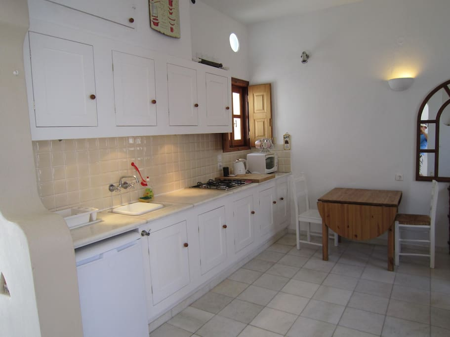 Kitchen - open plan and made with Paros marble.