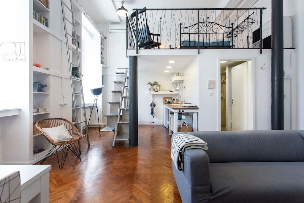 A former tobacco factory boss's office was converted into an artist's studio loft style accommodation with huge windows, high ceilings and lots of character.