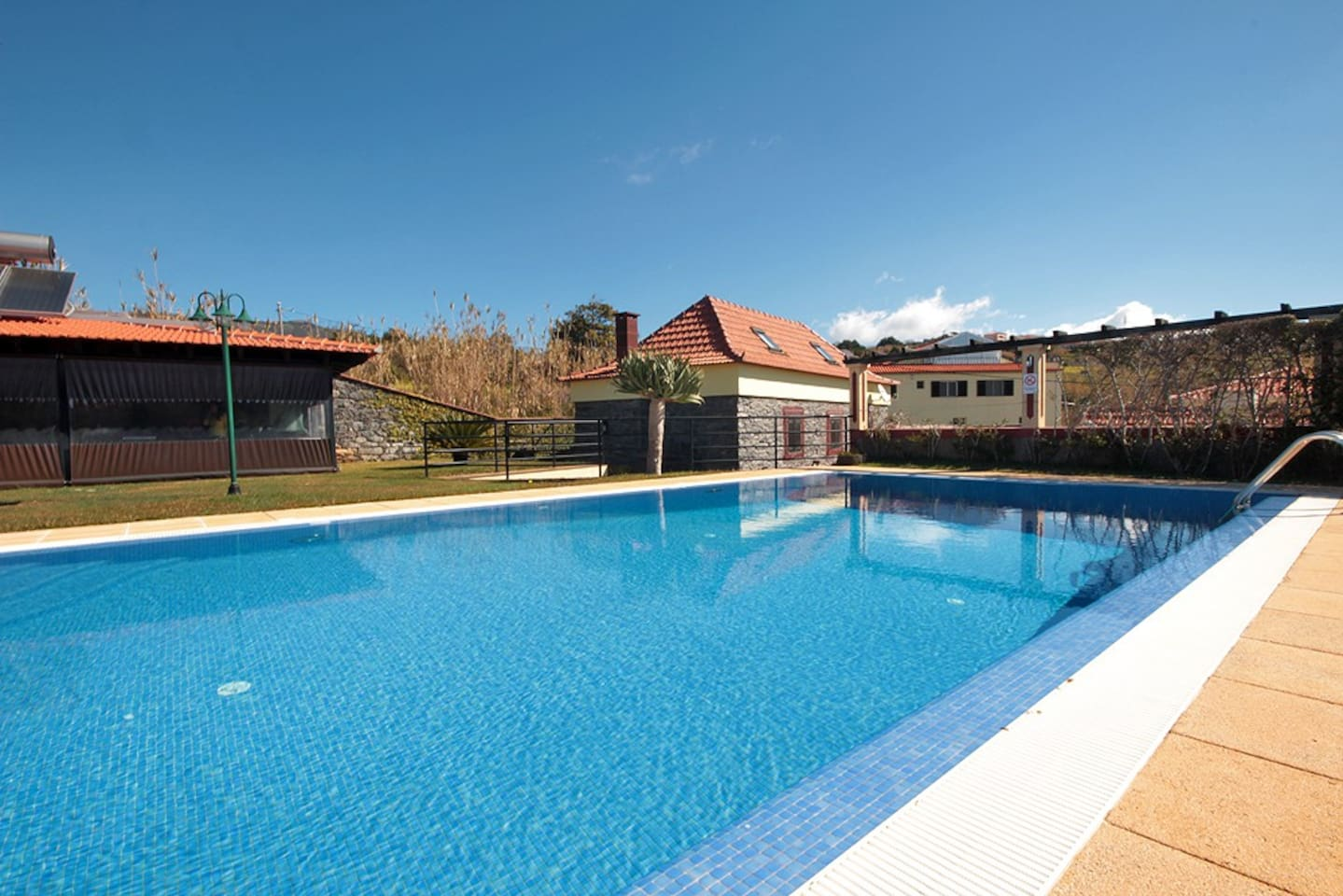 Pool and house in the background