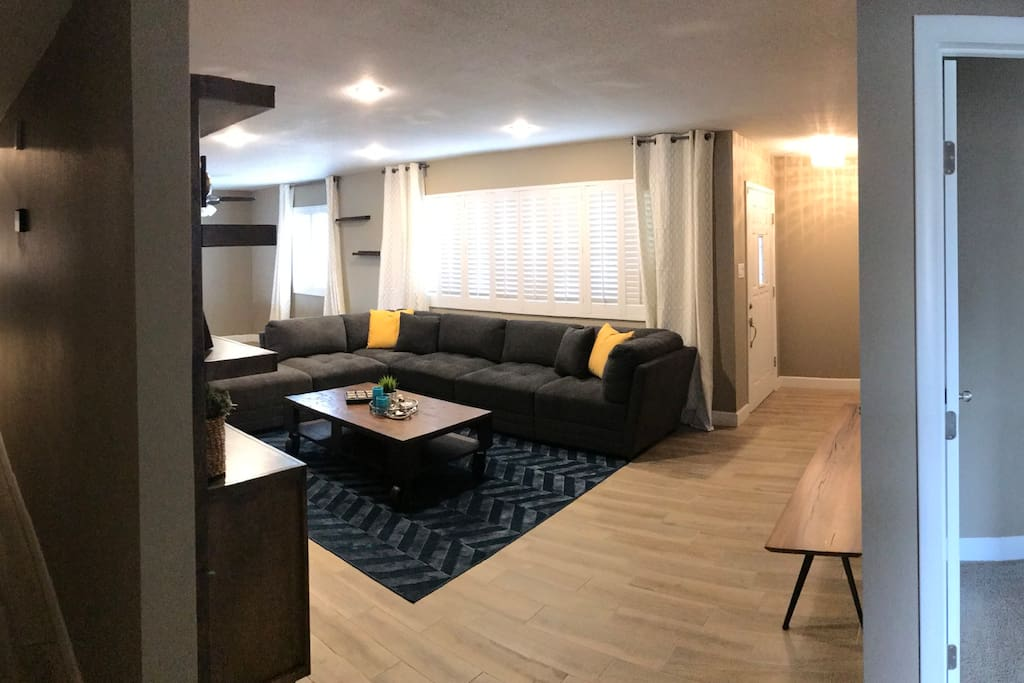 Spacious living area with sleeper sofa, TV.