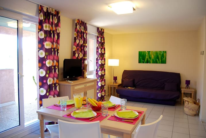 Welcome to our charming apartment by the beach!