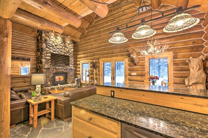 The cabin takes on a true rustic feel with log, stone, and animal decor.