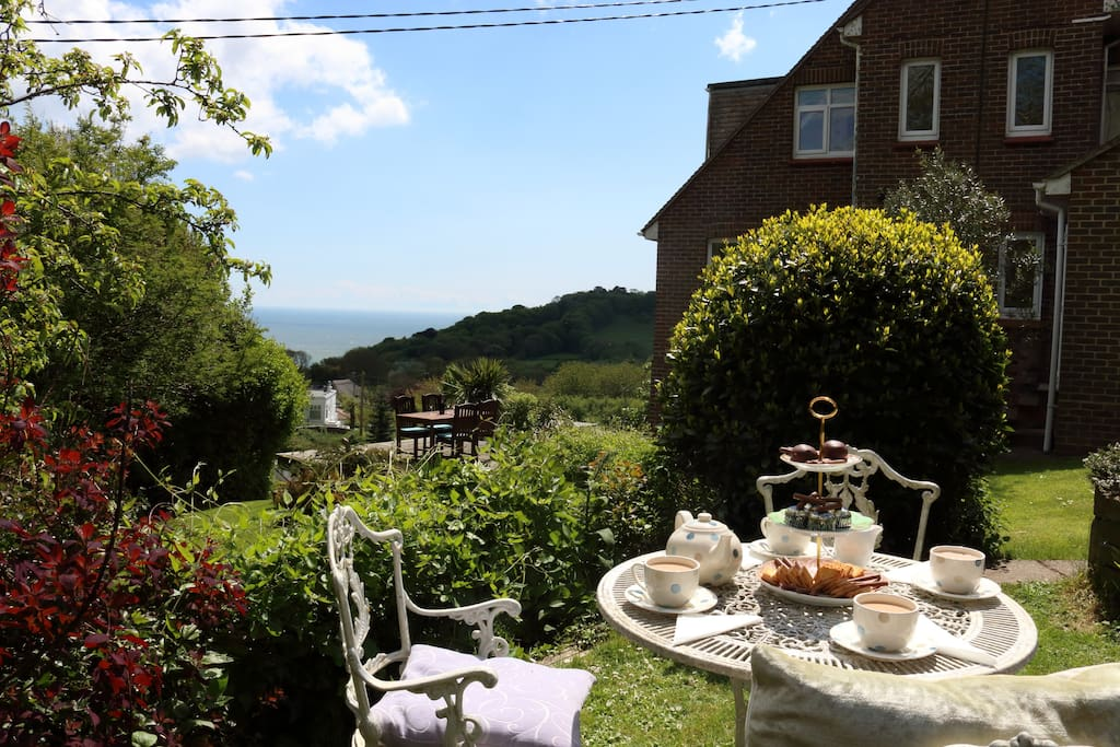 You could take your afternoon tea in the garden, gazing out over the sea and downs.