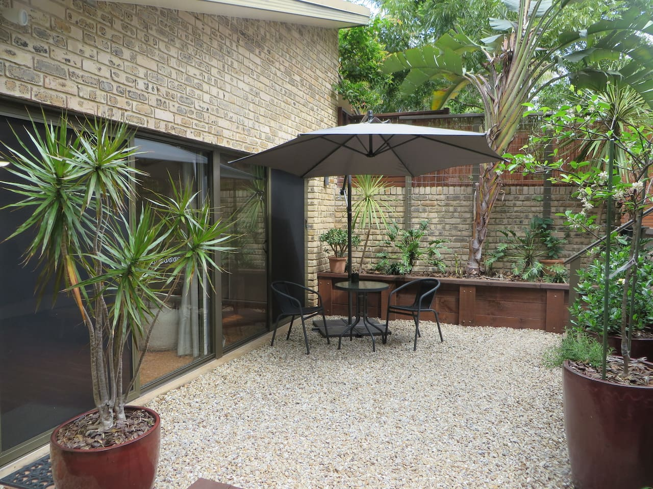 Your private courtyard for relaxing - BBQ and fire pit available on request.