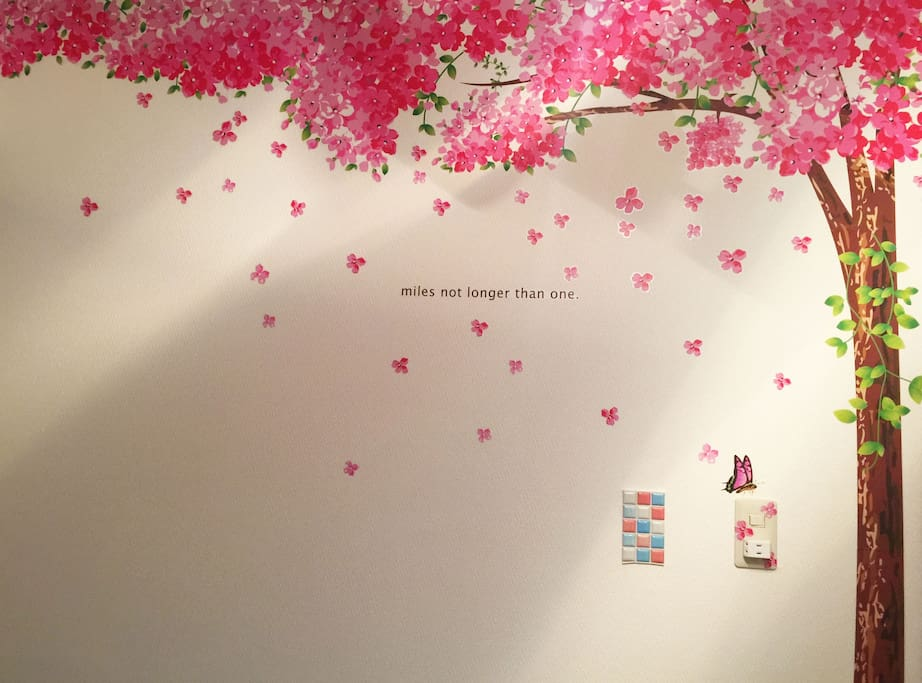 The wall with Sakura tree design