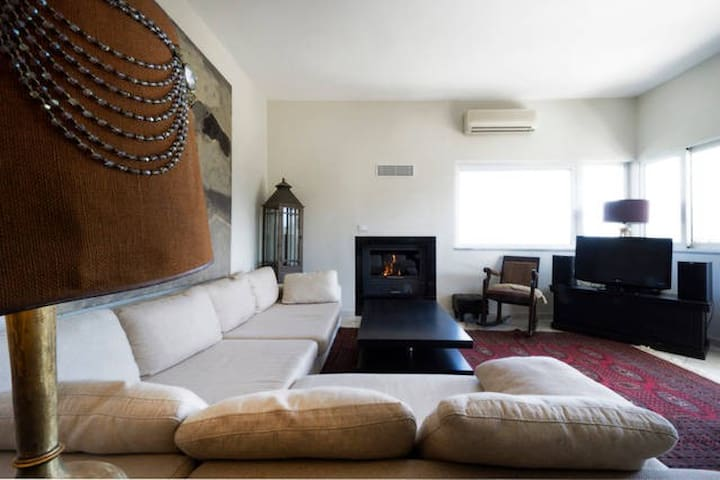 living room, fire place, tv-stereo and big corner sofa