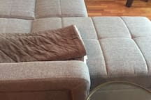 Sofa expands into a mini-full sized bed.