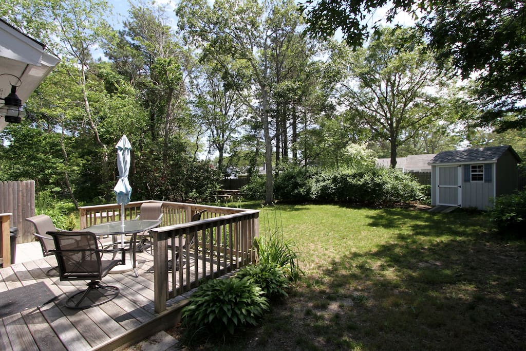 Landscaped backyard with a picnic table for your seafood feasts.