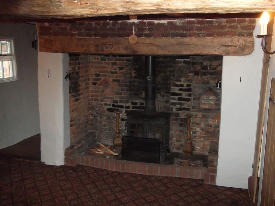 The large Inglenook fireplace takes centre stage in the entrance hall