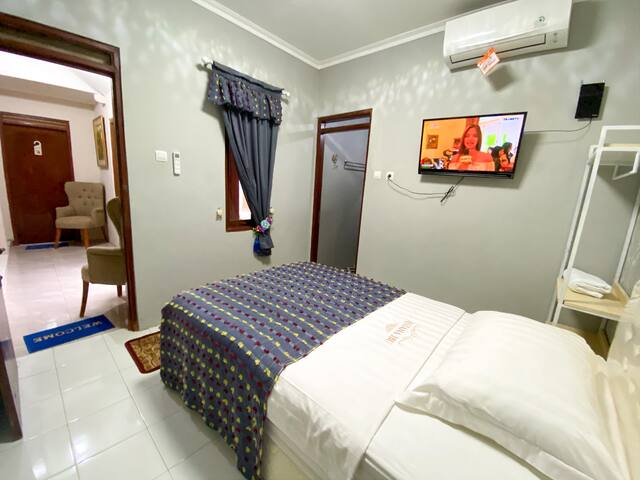 Single Room (kamara single bed dengan luar yang ideal untuk 1 orang dengan warna abu-abu)